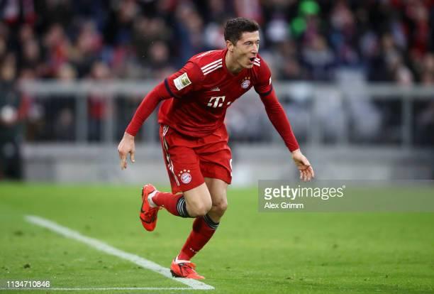 Robert Lewandowski of Bayern Munich scores his team's sixth goal during the Bundesliga match between FC Bayern Muenchen and VfL Wolfsburg at Allianz...