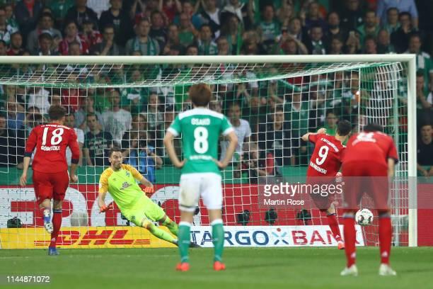 Robert Lewandowski of Bayern Munich scores his team's third goal during the DFB Cup semi final match between Werder Bremen and FC Bayern Muenchen at...