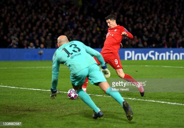 Robert Lewandowski of Bayern Munich scores his team's third goal during the UEFA Champions League round of 16 first leg match between Chelsea FC and...