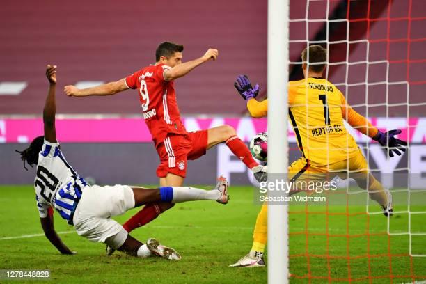 Robert Lewandowski of Bayern Munich scores his team's third goal during the Bundesliga match between FC Bayern Muenchen and Hertha BSC at Allianz...
