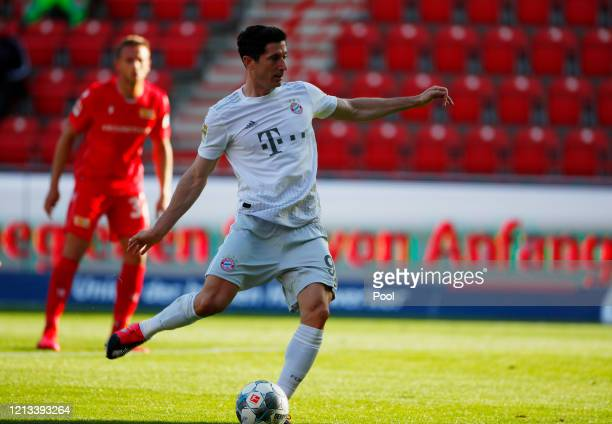 Robert Lewandowski of Bayern Munich scores their first goal from the penalty spot during the Bundesliga match between 1 FC Union Berlin and FC Bayern...