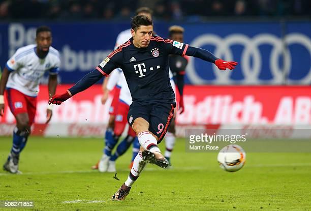 Robert Lewandowski of Bayern Munich scores their first goal from the penalty spot during the Bundesliga match between Hamburger SV and FC Bayern...
