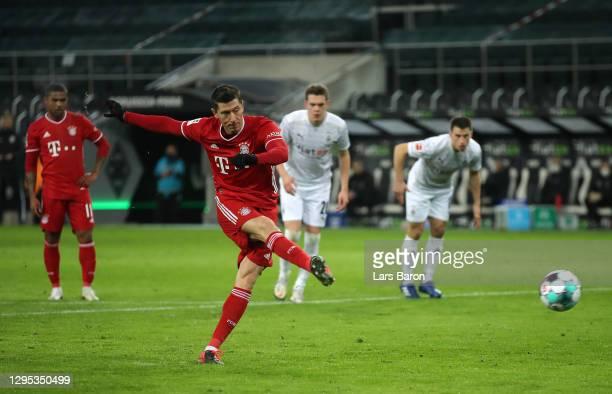 Robert Lewandowski of Bayern Munich scores their sides first goal from the penalty spot during the Bundesliga match between Borussia Moenchengladbach...