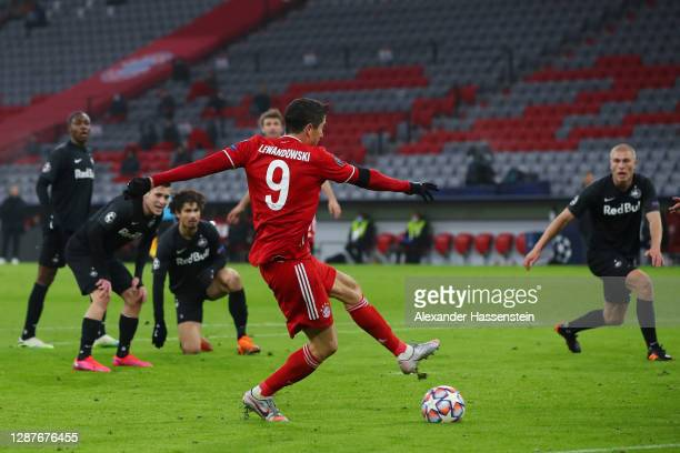 Robert Lewandowski of Bayern Munich scores their team's first goal during the UEFA Champions League Group A stage match between FC Bayern Muenchen...