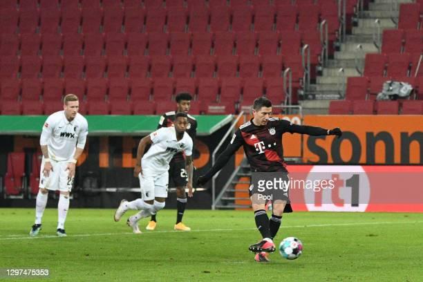Robert Lewandowski of Bayern Munich scores their team's first goal from the penalty spot during the Bundesliga match between FC Augsburg and FC...