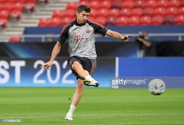 Robert Lewandowski of Bayern Munich shoots during a training session ahead of their UEFA Super Cup match against Sevilla at Stadium Puskas Ferenc on...