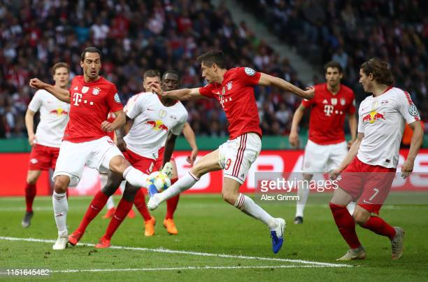 Robert Lewandowski of Bayern Munich shoots during the DFB Cup final between RB Leipzig and Bayern Muenchen at Olympiastadion on May 25 2019 in Berlin...