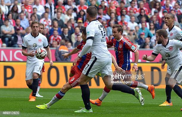 Robert Lewandowski of Bayern Munich shoots goal to 1-0 while Bastian Oczipka and Alexander Madlung of Frankfurt are watching during the Bundesliga...