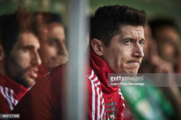 Robert Lewandowski of Bayern Munich sits on the bench during the Bundesliga match between FC Augsburg and FC Bayern Muenchen at WWKArena on April 7...