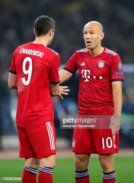 Robert Lewandowski of Bayern Munich speaks with Arjen Robben of Bayern Munich during the Group E match of the UEFA Champions League between AEK...