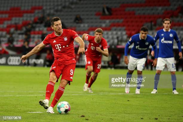 Robert Lewandowski of Bayern Munich takes and scores a penalty during the Bundesliga match between FC Bayern Muenchen and FC Schalke 04 at Allianz...