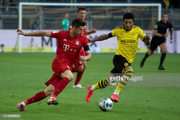 Robert Lewandowski of Bayern Munich takes on Jadon Sancho of Borussia Dortmund during the Bundesliga match between Borussia Dortmund and FC Bayern...
