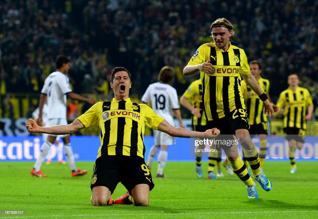 Robert Lewandowski of Borussia Dortmund celebrates after scoring his team's third goal during the UEFA Champions League semi final first leg match between Borussia Dortmund and Real Madrid at Signal Iduna Park on April 24, 2013 in Dortmund, Germany.