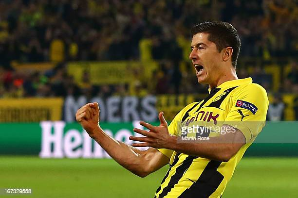 Robert Lewandowski of Borussia Dortmund celebrates scoring the opening goal during the UEFA Champions League semi final first leg match between...