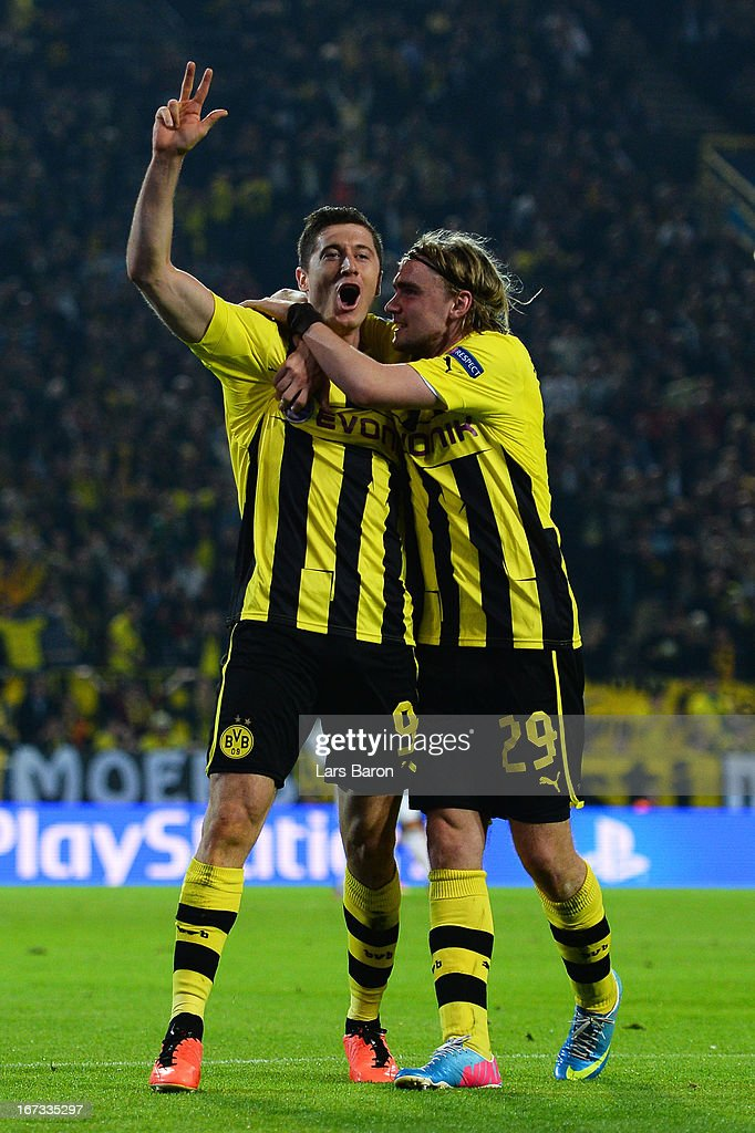 Robert Lewandowski of Borussia Dortmund celebrates scoring their third goal and his hat-trick with team mate Marcel Schmelzer of Borussia Dortmund during the UEFA Champions League semi final first leg match between Borussia Dortmund and Real Madrid at Signal Iduna Park on April 24, 2013 in Dortmund, Germany.