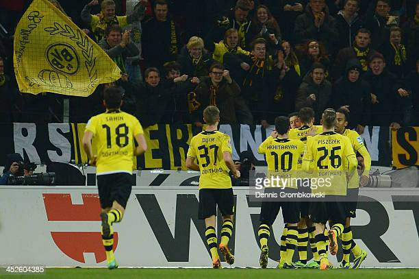 Robert Lewandowski of Borussia Dortmund celebrates with teammates after scoring his team's second goal from a penalty during the Bundesliga match...