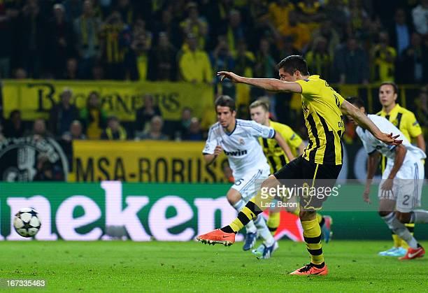 Robert Lewandowski of Borussia Dortmund scores his team's fourth goal from the penalty spot during the UEFA Champions League semi final first leg...