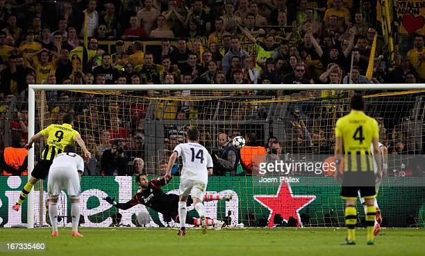 Robert Lewandowski of Borussia Dortmund scores their fourth goal from the penalty spot during the UEFA Champions League semi final first leg match...