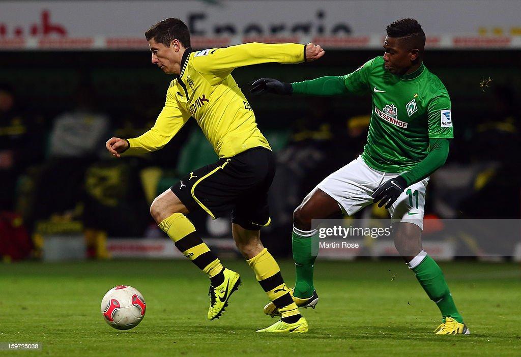 Robert Lewandowski (L) of Bremen and Eljero Elia(R) of Dortmund battle for the ball during the Bundesliga match between Werder Bremen and Borussia Dortmund at Weser Stadium on January 19, 2013 in Bremen, Germany.