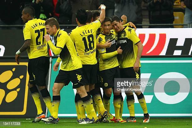 Robert Lewandowski of Dormtund celebrates the first goal with Moritz Leitner and Lucas Barrios during the Bundesliga match between Borussia Dortmund...