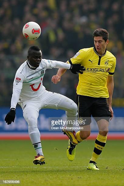 Robert Lewandowski of Dortmund and Didier Ya Konan of Hannover battle for the ball during the Bundesliga match between Borussia Dortmund and Hannover...