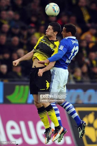 Robert Lewandowski of Dortmund and Jermaine Jones of Schalke jump for a header during the Bundesliga match between Borussia Dortmund and FC Schalke...