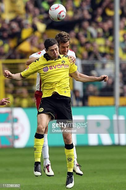Robert Lewandowski of Dortmund and Stefan Reisinger of Freiburg go up for a header during the Bundesliga match between Borussia Dortmund and SC...