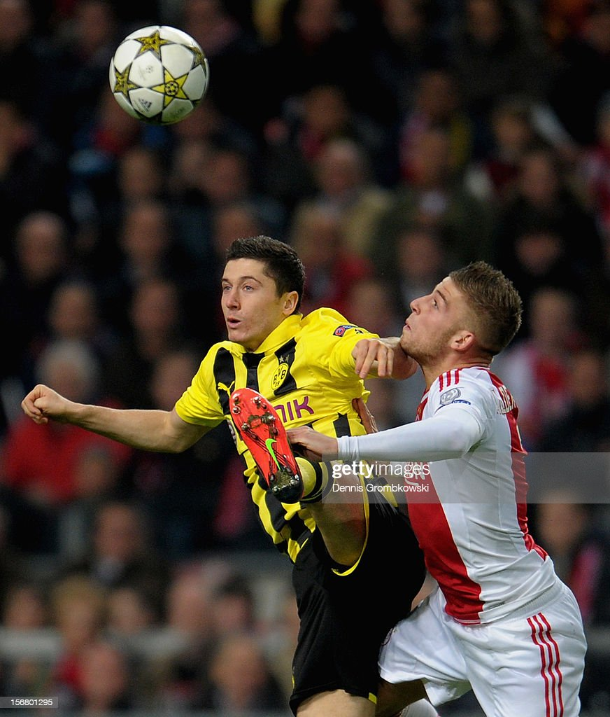 Robert Lewandowski of Dortmund and Toby Alderweireld of Amsterdam go up for a header during the UEFA Champions League Group D match between Ajax Amsterdam and Borussia Dortmund at Amsterdam Arena on November 21, 2012 in Amsterdam, Netherlands.