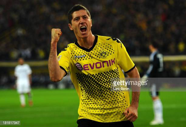 Robert Lewandowski of Dortmund celebrates after scoring his teams fourth goal during the Bundesliga match between Borussia Dortmund and VfL Wolfsburg...