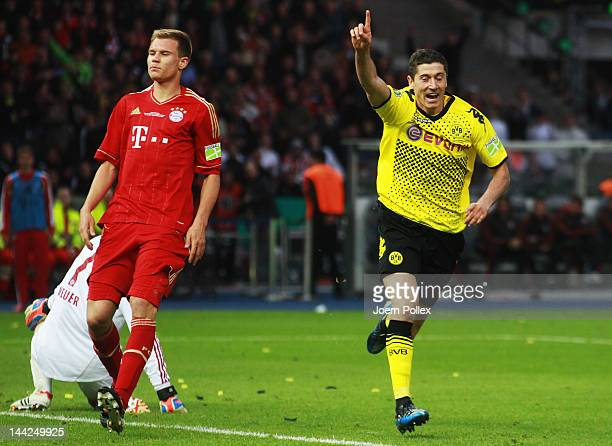 Robert Lewandowski of Dortmund celebrates after scoring his team's third goal during the DFB Cup final match between Borussia Dortmund and FC Bayern...