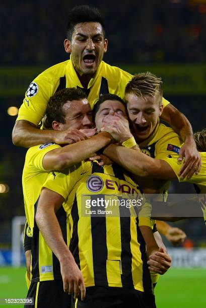 Robert Lewandowski of Dortmund celebrates after scoring his teams first goal during the UEFA Champions League group D match between Borussia Dortmund...
