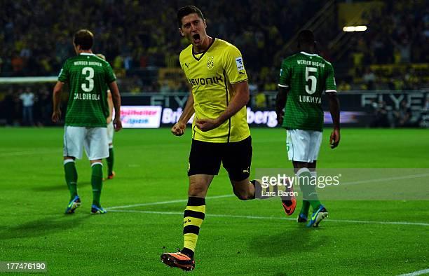 Robert Lewandowski of Dortmund celebrates after scoring his teams first goal during the Bundesliga match between Borussia Dortmund and Werder Bremen...