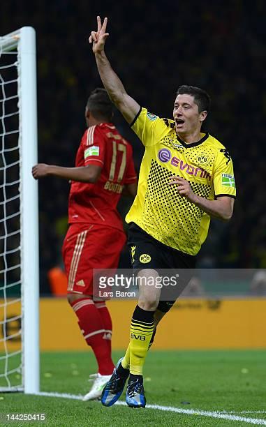 Robert Lewandowski of Dortmund celebrates after scoring his third and his teams fives goal during the DFB Cup final match between Borussia Dortmund...