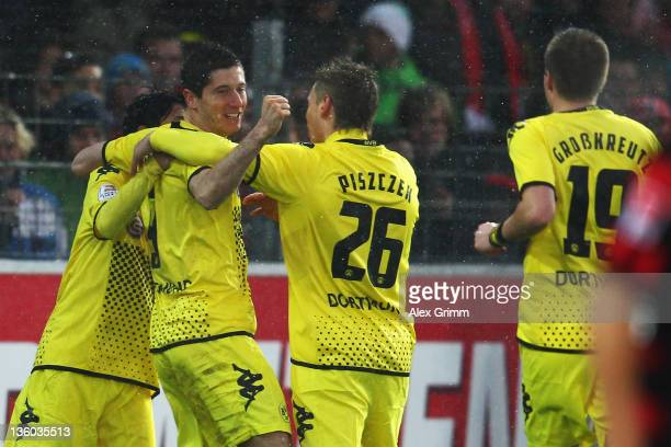 Robert Lewandowski of Dortmund celebrates his team's first goal during the Bundesliga match between SC Freiburg and Borussia Dortmund at Badenova...