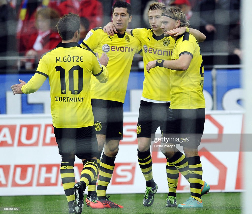 Robert Lewandowski of Dortmund celebrates his team's first goal with team mates (L-R) Mario Goetze, Marco Reus and Marcel Schmelzer during the Bundesliga match between 1. FSV Mainz 05 and Borussia Dortmund at Coface Arena on November 24, 2012 in Mainz, Germany.