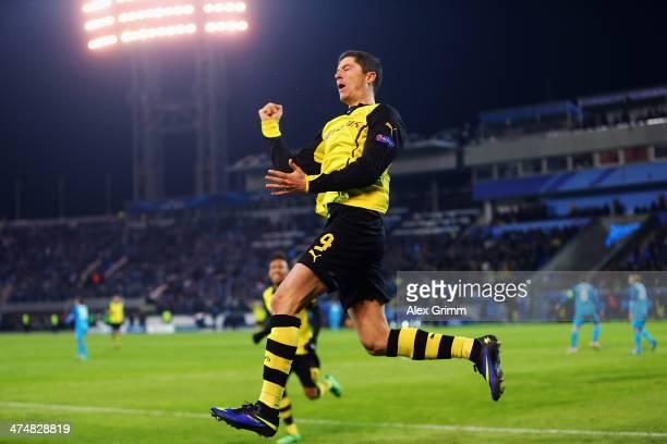 Robert Lewandowski of Dortmund celebrates his team's fourth goal during the UEFA Champions League Round of 16 match between FC Zenit and Borussia...