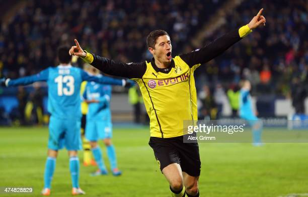 Robert Lewandowski of Dortmund celebrates his team's fourth goal during the UEFA Champions League Round of 16 match between FC Zenit and Borussia...