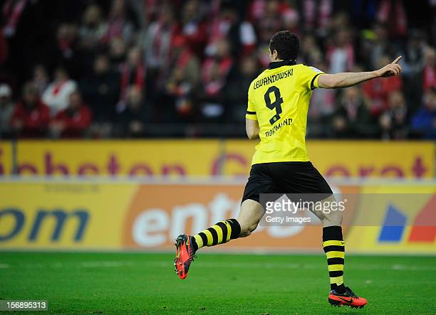 Robert Lewandowski of Dortmund celebrates his team's second goal during the Bundesliga match between 1 FSV Mainz 05 and Borussia Dortmund at Coface...