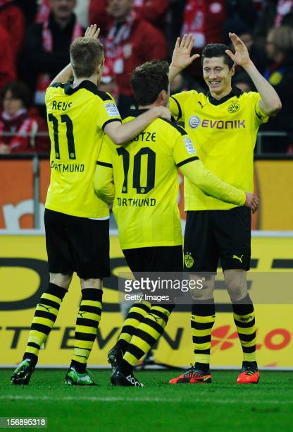 Robert Lewandowski of Dortmund celebrates his team's second goal with team mates Marco Reus and Mario Goetze during the Bundesliga match between 1...