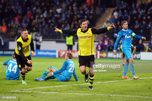 Robert Lewandowski of Dortmund celebrates his team's third goal during the UEFA Champions League Round of 16 match between FC Zenit and Borussia...