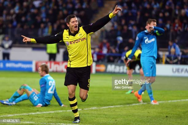 Robert Lewandowski of Dortmund celebrates his team's third goal during the UEFA Champions League Round of 16 match between FC Zenit and Borussia...