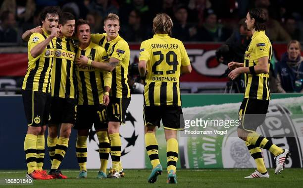 Robert Lewandowski of Dortmund celebrates scoring the third goal with his team during the UEFA Champions League Group D match between Ajax Amsterdam...
