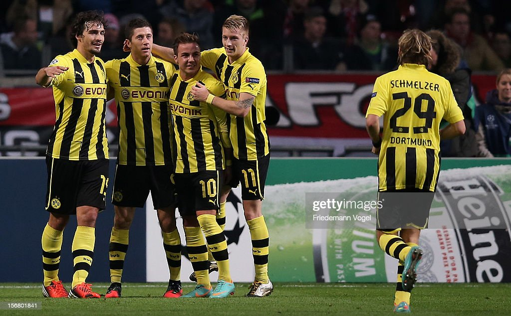 Robert Lewandowski (2f.L) of Dortmund celebrates scoring the third goal with his team during the UEFA Champions League Group D match between Ajax Amsterdam and Borussia Dortmund at Amsterdam Arena on November 21, 2012 in Amsterdam, Netherlands.