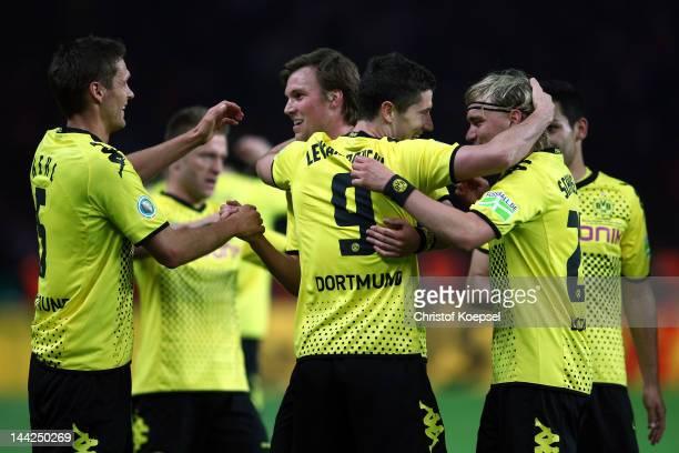 Robert Lewandowski of Dortmund celebrates the forth goal with Marcel Schmelzer Sebastian Kehl and Kevin Grosskreutz of Dortmund during the DFB Cup...