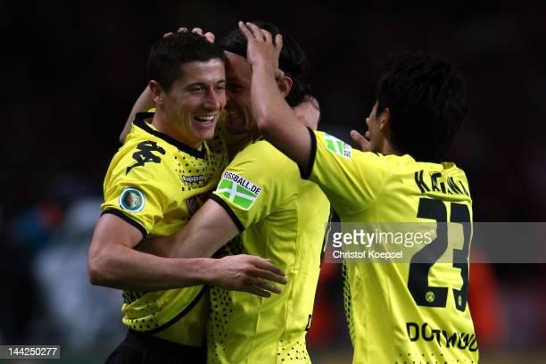 Robert Lewandowski of Dortmund celebrates the forth goal with Neven Subotic and Shinji Kagawa of Dortmund during the DFB Cup final match between...