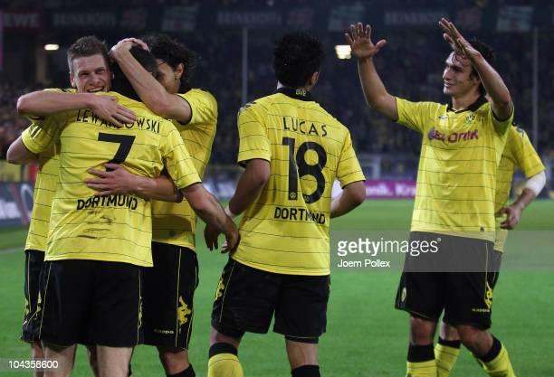 Robert Lewandowski of Dortmund celebrates with his team mates after scoring his team's fourth goal during the Bundesliga match between Borussia...