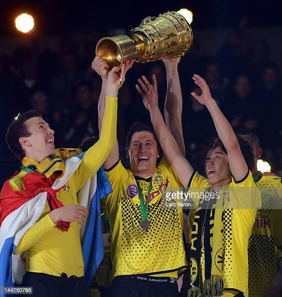 Robert Lewandowski of Dortmund celebrates with his team mates winning the DFB Cup final match between Borussia Dortmund and FC Bayern Muenchen at...