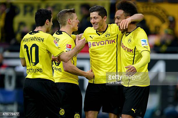 Robert Lewandowski of Dortmund celebrates with team mates after scoring the second goal during the Bundesliga match between Borussia Dortmund and 1...