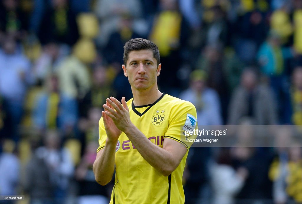 Robert Lewandowski of Dortmund celebrates with the fans after winning the Bundesliga match between Borussia Dortmund and TSG 1899 Hoffenheim at Signal Iduna Park on May 3, 2014 in Dortmund, Germany.