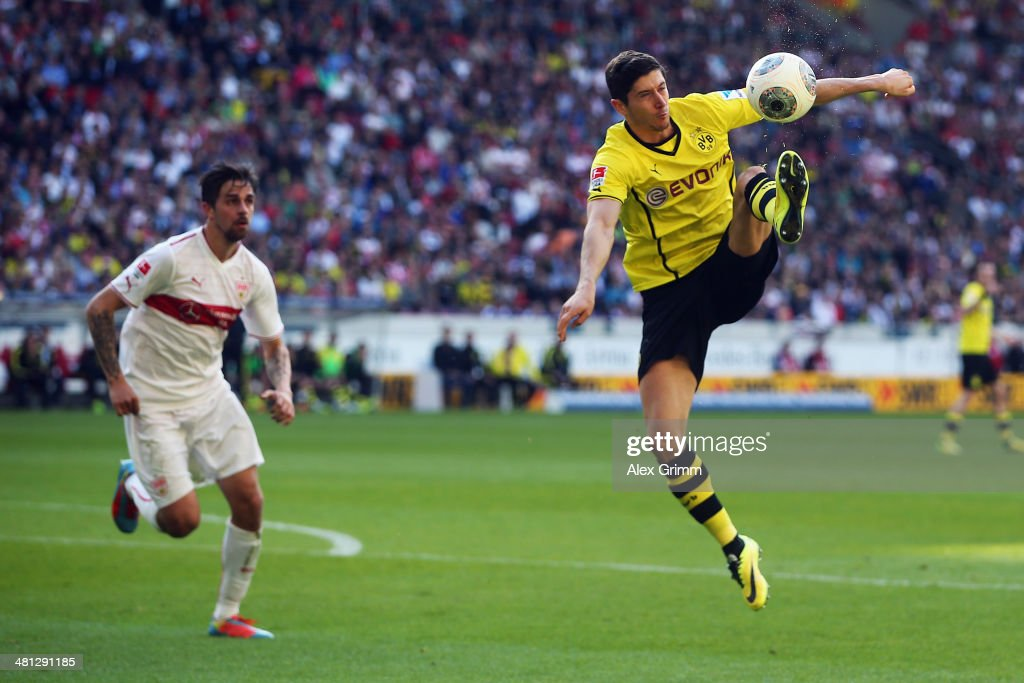 Robert Lewandowski of Dortmund controles the ball ahead of Martin Harnik of Stuttgart during the Bundesliga match between VfB Stuttgart and Borussia Dortmund at Mercedes-Benz Arena on March 29, 2014 in Stuttgart, Germany.